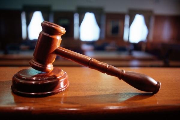 Повідомлено про підозру трьом членам злочинного угрупування у вчиненні низки злочинів